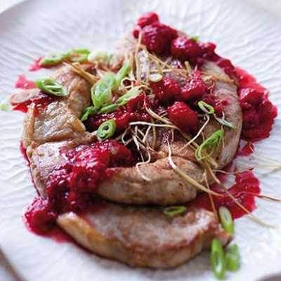 Pork steaks with cassis raspberry sauce and ginger straws
