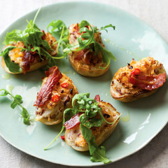 Potato skins stuffed with bacon and rocket