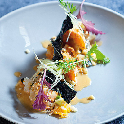 Prawns with butternut rice, red curry cream and seaweed crisps