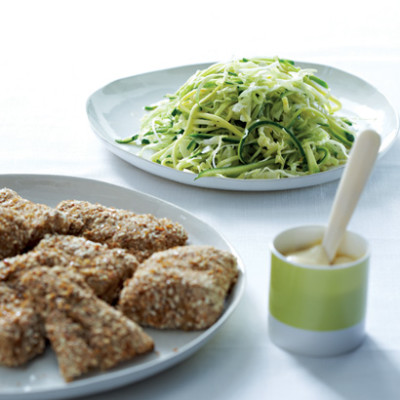 Pretzel-crumbed fish fillets with mustard mayonnaise and summer squash slaw