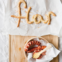Pretzel letters with bratwurst and mustard
