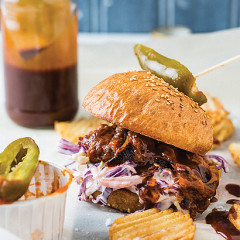 Pulled beef sandwich with coleslaw and crinkle-cut chips