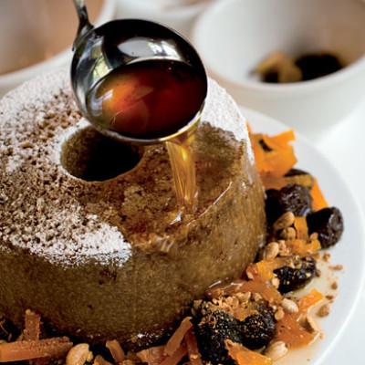 Pumpkin cake with prunes in dessert wine syrup and candied pumpkin
