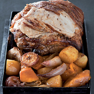 Roast pork with pumpkin and baby apples
