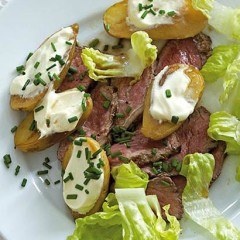 Roast steak and potato salad with sour cream and chives