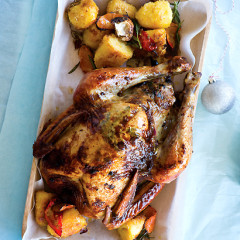 Roast turkey with pear stuffing and roast potatoes