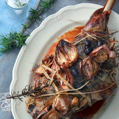 Rosemary and garlic leg of lamb with caramelised shallots and black olives