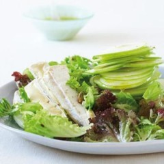 Salad of organic green leaves, apple, pistachios and organic Brie with apple vinaigrette