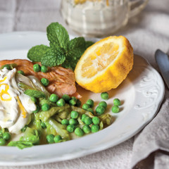 Salmon with wilted lettuce and pea salad and minted creme fraiche
