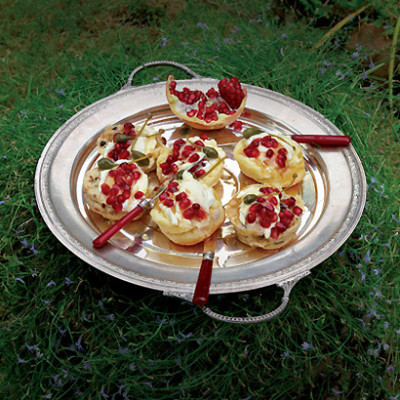 Scones with creme fraiche, pomegranate and caperberries