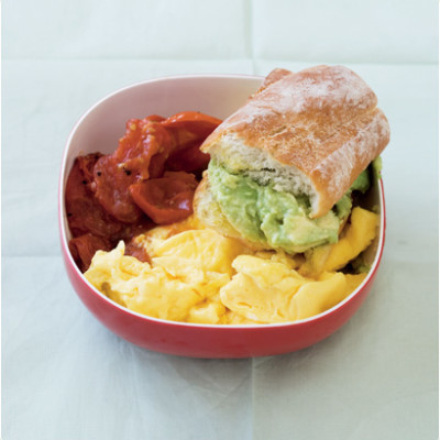 Scrambled egg and roasted tomato with crispy, smashed avocado-stuffed baguettes