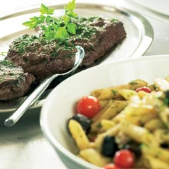 Seared ostrich steaks with tapenade and pasta