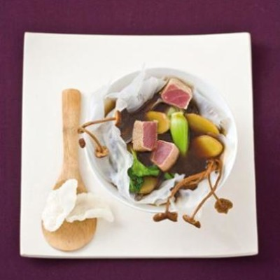 Seared tuna, ginger and dried mushroom broth in a starch sheet bowl