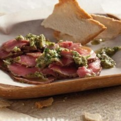 Slivers of beef carpaccio with a zesty caper dressing and melba toasts