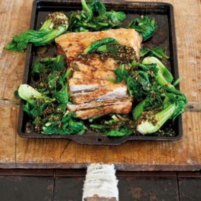 Slow-roasted pork belly with wilted bok choy, tatsoi and asian dressing