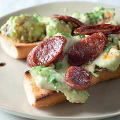 Smashed avocado and chorizo-topped French loaf