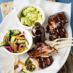 Smoked pork ribs with guacamole, red onion and vegetable pickles