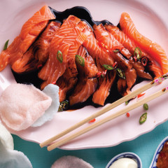 Soya, ginger and chilli dressed salmon sashimi with prawn crackers