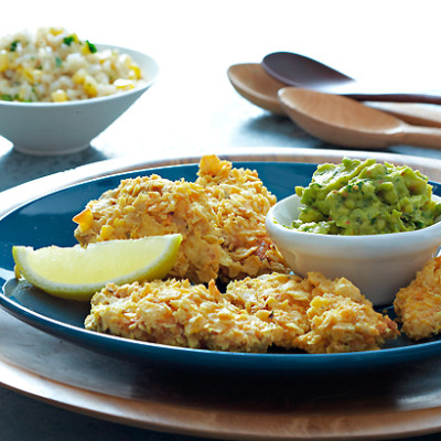 Spiced nacho-crumbed chicken with avocado and fresh corn rice