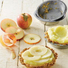 Spiced puree apple tarts with oat crust topped with slow poached apples