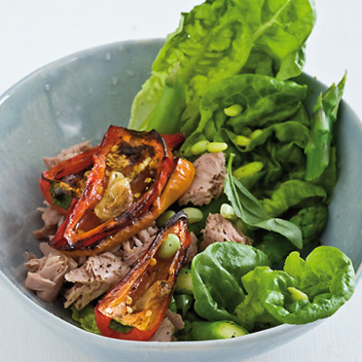 Spring tuna green salad served with garlicky blackened baby pepper