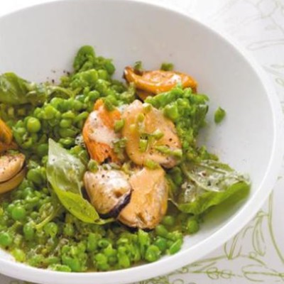 Steamed mussels tossed with smashed peas and drenched in lemon and chilli butter