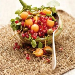 Sweet melon and pomegranate salad with caper berries