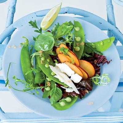 Sweet pea, fresh plum and feta salad with organic avocado oil
