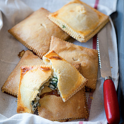 Three-cheese and baby spinach pies