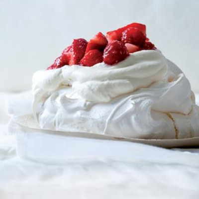 Traditional pavlova with berries and cream