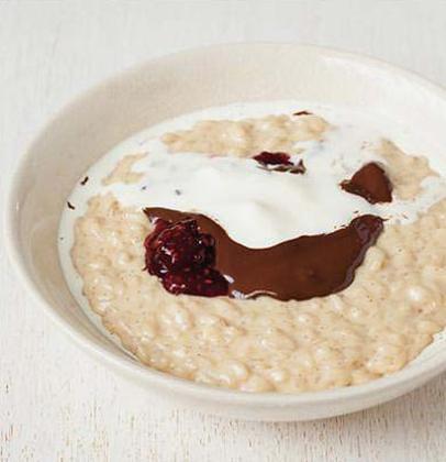 Vanilla rice pudding with strawberry jam and dark ...
