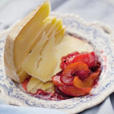 Verjuice-poached stone fruit with a wedge of cheese
