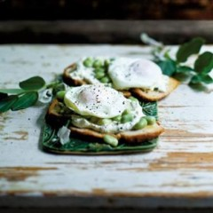 Wafer crostini toasts topped with smooth chive cheese, broad beans and soft-poached eggs
