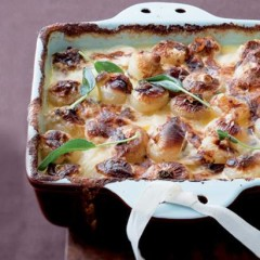 Wafer-thin potato bake with sweet baby onions