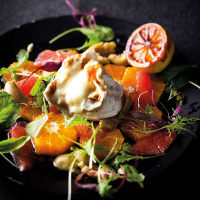 Warm goat's cheese and citrus salad with caramelised lemon dressing