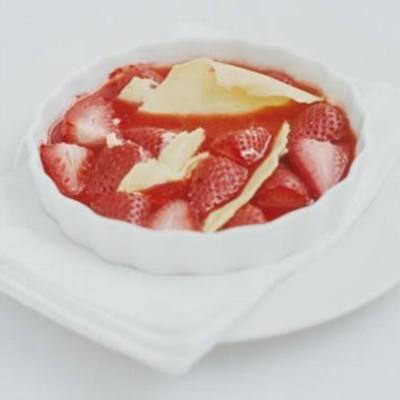 Warm organic strawberries with organic white chocolate