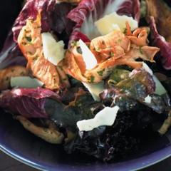Warm oyster mushroom salad on red leaves
