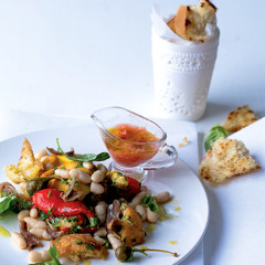 White bean panzanella salad with tomato dressing, caperberries and anchovies