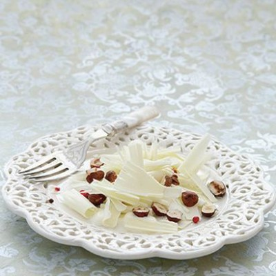 White organic chocolate carpaccio with creme fraiche, toasted hazelnuts and pink peppercorns