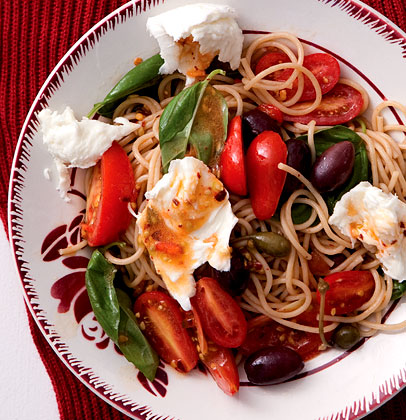 Wholewheat spaghetti tossed with sun-ripened tomatoes, fresh basil and ...