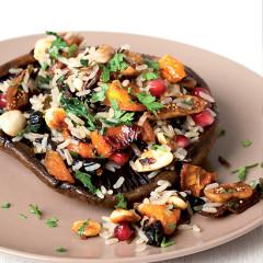 Wild brown rice salad on grilled brown mushrooms