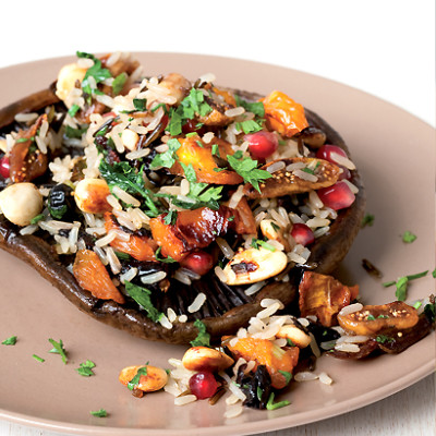 Wild brown rice salad on grilled brown mushrooms