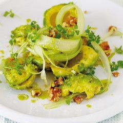 Zesty avocado salad with roasted walnuts, celery and mustard cress sprouts