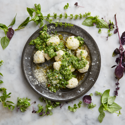 Homemade ricotta gnocchi with basil-and-celery leaf pesto