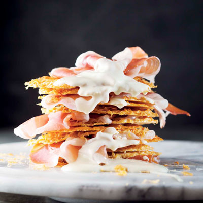 Grana Padano-crisp tower with Parma ham and white chocolate drizzle