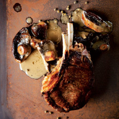 Thick-cut rib-eye with mushroom and green peppercorn sauce