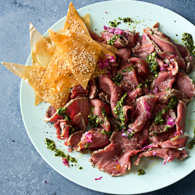 Beef carpaccio with coriander, chilli and lime pesto and phyllo sesame chips