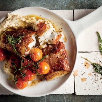 Parma ham-wrapped fish with vine tomatoes