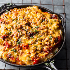 Baked mielie rice tart with tomato sauce, cheese, chilli and herbs
