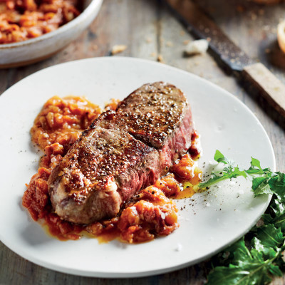 Grilled steaks with tomato-and-anchovy sauce